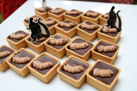 Chocolate tarts are decorated with the monster Mothra's larvae at
