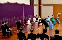Emperor Akihito and Empress Michiko and other members of the Imperial Family attend the New Year poetry reading ceremony at the Imperial Palace in Tokyo on Jan. 16, 2019. (Pool photo)