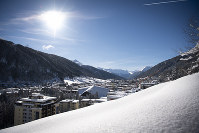 The sun shines as buildings are covered with snow in Davos, Switzerland, on Jan. 15, 2019. (Gian Ehrenzeller/Keystone via AP)