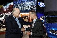 Ford Motor Co. President and CEO, Jim Hackett, left, meets with Dr. Herbert Diess, CEO of Volkswagen AG, on Jan. 14, 2019, at the North American International Auto Show in Detroit. (AP Photo/Carlos Osorio)