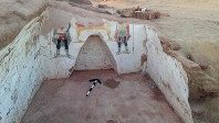This undated handout photo from the Egyptian Antiquities Authority, shows colorful funeral paintings in an ancient tomb dating back to the Roman period, at the Dakhla Oasis in the Western Desert, Egypt. (Egyptian Antiquities Authority via AP)