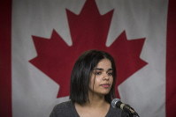 Rahaf Mohammed makes a public statement in Toronto, Canada, on Jan. 15, 2019. (Tijana Martin/The Canadian Press via AP)