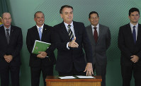Brazil's President Jair Bolsonaro gives a thumb up after signing a decree that loosens restrictions on owning a firearm at Planalto presidential palace in Brasilia, Brazil, on Jan. 15, 2019. (AP Photo/Eraldo Peres)