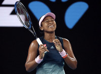 Japan's Naomi Osaka smiles during her first round match against Poland's Magda Linette at the Australian Open tennis championships in Melbourne, Australia, on Jan. 15, 2019. (AP Photo/Kin Cheung)