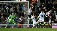 Newcastle United's Callum Roberts, right, scores a goal during the Emirates FA Cup third round replay soccer match at Ewood Park, Blackburn, on Jan. 15, 2019. (Martin Rickett/PA via AP)