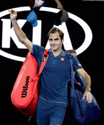 Switzerland's Roger Federer waves to the crowd after defeating Uzbekistan's Denis Istomin during their first round match at the Australian Open tennis championships in Melbourne, Australia, on Jan. 14, 2019. (AP Photo/Aaron Favila)