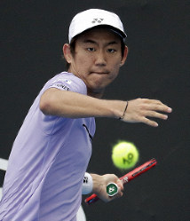 Japan's Yoshihito Nishioka makes a forehand return to Russia's Karen Khachanov during their second round match at the Australian Open tennis championships in Melbourne, Australia, on Jan. 16, 2019. (AP Photo/Aaron Favila)