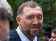 In this July 2, 2015, file photo, Russian metals magnate Oleg Deripaska attends Independence Day celebrations at Spaso House, the residence of the American Ambassador, in Moscow, Russia. (AP Photo/Alexander Zemlianichenko)