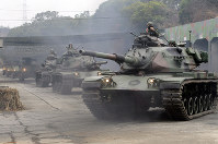 M60A3 Patton tanks move during a military exercises in Taichung, central Taiwan, on Jan. 17, 2019. (AP Photo/Chiang Ying-ying)