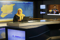 This undated photo provided by Iranian state TV's English-language service, Press TV, shows American-born news anchor Marzieh Hashemi at the studio in Tehran, Iran. (Press TV via AP)