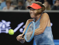 Russia's Maria Sharapova makes a backhand return to Sweden's Rebecca Peterson during their second round match at the Australian Open tennis championships in Melbourne, Australia, on Jan. 16, 2019. (AP Photo/Aaron Favila)