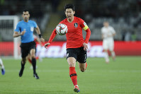South Korea's forward Son Heung-Min runs with the ball during the AFC Asian Cup group C soccer match between South Korea and China at Al Nahyan Stadium in Abu Dhabi, United Arab Emirates, on Jan. 16, 2019. (AP Photo/Hassan Ammar)