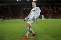 Derby County's Martyn Waghorn celebrates scoring his side's second goal of the game against Southampton, during their English FA Cup third round replay soccer match at St Mary's Stadium in Southampton, England, on Jan. 16, 2019. (Nick Potts/PA via AP)
