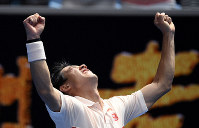 Japan's Kei Nishikori celebrates after defeating Croatia's Ivo Karlovic during their second round match at the Australian Open tennis championships in Melbourne, Australia, on Jan. 17, 2019. (AP Photo/Andy Brownbill)