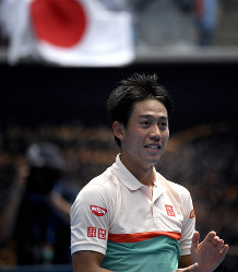Japan's Kei Nishikori celebrates after defeating Croatia's Ivo Karlovic in their second round match at the Australian Open tennis championships in Melbourne, Australia, on Jan. 17, 2019. (AP Photo/Andy Brownbill)