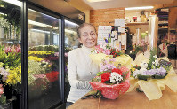 Teruko Morimoto smiles at her flower shop in Kobe's Hyogo Ward, reopened 14 years after the Great Hanshin Earthquake of 1995. (Mainichi/Kentaro Ikushima)