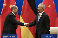 German Finance Minister Olaf Scholz, left, shakes hands with Chinese Vice Premier Liu He after they witnessed a signing ceremony for the China-Germany High Level Financial Dialogue at the Diaoyutai State Guesthouse in Beijing, on Jan. 18, 2019. (AP Photo/Andy Wong, Pool)