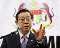 Malaysian Finance Minister Lim Guan Eng gestures during a press conference at Finance Ministry in Putrajaya, Malaysia, on Jan. 18, 2019. (AP Photo/Vincent Thian)