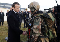 French President Emmanuel Macron meets paratroopers of the 11th Brigade of the Paratroopers of the Infantry before delivering his new year address to military forces at Toulouse-Francazal air base, near Toulouse, southern France, on Jan.17 Jan. 2019. (Guillaume Horcajuelo, Pool via AP)
