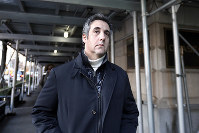In this Dec. 7, 2018 file photo, Michael Cohen, former lawyer to President Donald Trump, leaves his apartment building in New York. (AP Photo/Richard Drew)