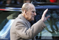 In this Dec. 25, 2016 file photo, Britain's Prince Philip waves to the public as he leaves after attending a Christmas day church service in Sandringham, England. (AP Photo/Kirsty Wigglesworth)