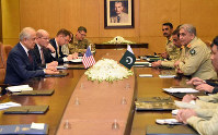 In this photo released by Inter Services Public Relations of Pakistan's military, U.S. peace envoy Zalmay Khalilzad, left, talks with Pakistani Army Chief Gen. Qamar Javed Bajwa, second from right, during a meeting in Rawalpindi, Pakistan, on Jan. 17, 2019. (Inter Services Public Relations via AP)
