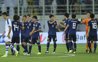 Japan players celebrate in the end of the AFC Asian Cup group F soccer match between Japan and Uzbekistan at Khalifa bin Zayed Stadium in Al Ain, United Arab Emirates, on Jan. 17, 2019. (AP Photo/Kamran Jebreili)