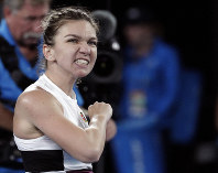Romania's Simona Halep celebrates after defeating United States' Sofia Kenin in their second round match at the Australian Open tennis championships in Melbourne, Australia, on Jan. 17, 2019. (AP Photo/Aaron Favila)