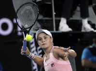 Australia's Ashleigh Barty celebrates after defeating Greece's Maria Sakkari during their third round match at the Australian Open tennis championships in Melbourne, Australia, on Jan. 18, 2019. (AP Photo/Kin Cheung)