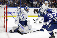 Toronto Maple Leafs goaltender Frederik Andersen (31) makes a save on a shot by Tampa Bay Lightning center Yanni Gourde (37) during the second period of an NHL hockey game, on Jan. 17, 2019, in Tampa, Fla. (AP Photo/Chris O'Meara)