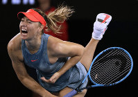 Russia's Maria Sharapova serves to Denmark's Caroline Wozniacki during their third round match at the Australian Open tennis championships in Melbourne, Australia, on Jan. 18, 2019. (AP Photo/Kin Cheung)