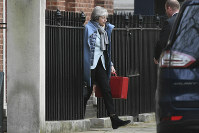 Britain's Prime Minister Theresa May leaves 10 Downing Street, in London, on Jan. 18, 2019. (Stefan Rousseau/PA via AP)
