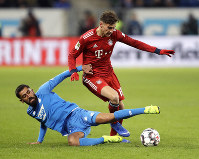 Hoffenheim's Kerem Demirbay, left, and Bayern's Leon Goretzka challenge for the ball during a German Bundesliga soccer match between TSG 1899 Hoffenheim and Bayern Munich in Sinsheim, Germany, on Jan. 18, 2019. (AP Photo/Michael Probst)