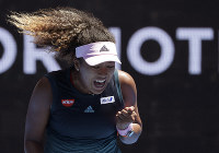 Japan's Naomi Osaka reacts after winning a point against Taiwan's Hsieh Su-Wei during their third round match at the Australian Open tennis championships in Melbourne, Australia, on Jan. 19, 2019. (AP Photo/Kin Cheung)