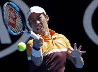 Japan's Kei Nishikori makes a forehand return to Portugal's Joao Sousa during their third round match at the Australian Open tennis championships in Melbourne, Australia, on Jan. 19, 2019. (AP Photo/Kin Cheung)