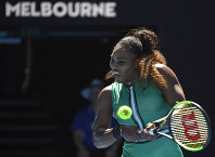 United States' Serena Williams makes a backhand return to Ukraine's Dayana Yastremska during their third round match at the Australian Open tennis championships in Melbourne, Australia, on Jan. 19, 2019. (AP Photo/Andy Brownbill)