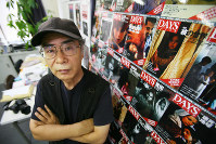 Photojournalist Ryuichi Hirokawa poses for a picture when he was the editor in chief of the monthly magazine DAYS JAPAN in this file photo dated August 2009. (Mainichi)