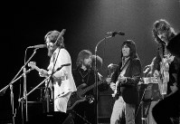 In this Aug. 1, 1971 file photo, Jesse Ed Davis, center right, a guitarist of Kiowa and Comanche ancestry, performs with George Harrison, left, formerly of the Beatles, at the Concert For Bangladesh at Madison Square Garden in New York City. Klaus Voorman is on bass, second from left, and Eric Clapton is at right.