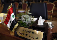 The chair of the Syrian Arab Republic is empty at the opening session of the Arab foreign ministers meeting ahead of a weekend Arab Economic Summit, in Beirut, Lebanon, Friday, Jan. 18, 2019. The Arab Economic and Social Development Summit, or AESD, is being held in Lebanon for the first time amid sharp divisions in the country and among Arab countries. (AP Photo/Hussein Malla)