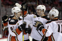 Anaheim Ducks players celebrate a goal by right wing Troy Terry, left, during the first period of an NHL hockey game against the New Jersey Devils, Saturday, Jan. 19, 2019, in Newark, N.J. (AP Photo/Julio Cortez)