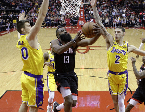 Houston Rockets guard James Harden (13) drives to the basket as Los Angeles Lakers center Ivica Zubac, left, and guard Lonzo Ball defend during the first half of an NBA basketball game Saturday, Jan. 19, 2019, in Houston. (AP Photo/Eric Christian Smith)