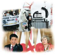 記者会見する安倍首相とメイ英首相はAP
