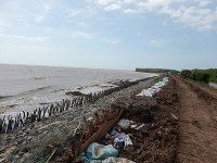 A coastline on the Mekong Delta in Vietnam, which is feared to be hit by floods caused by sea level rises, is seen in this photo provided by Makoto Tamura, associate professor of environmental policy at Ibaraki University. Coastal erosion is advancing and dikes are built and rebuilt, according to Tamura.