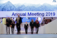 People walk up stairs at the congress center where the annual meeting of the World Economic Forum 2019 takes place in Davos, Switzerland, on Jan. 20, 2019. (AP Photo/Markus Schreiber)