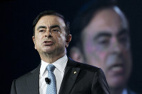 In this March 23, 2016, file photo, Carlos Ghosn, the Chairman and CEO of both Nissan and Renault, speaks at the New York International Auto Show in New York. (AP Photo/Mark Lennihan)