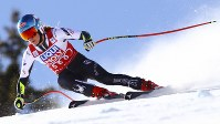 United States' Mikaela Shiffrin speeds down the course during an alpine ski, women's World Cup super-G in Cortina D'Ampezzo, Italy, on Jan. 20, 2019. (AP Photo/Marco Trovati)
