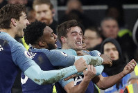 Tottenham Hotspur's Harry Winks, right celebrates after scoring his sides 2nd goal with teammates during the English Premier League soccer match between Fulham and Tottenham Hotspur at Craven Cottage in London, on Jan. 20, 2019. (AP Photo/Frank Augstein)