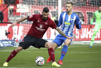 Nuremberg's Mikael Ishak, left, and Berlin's Arne Maier, right, challenge for the ball during the German Bundesliga soccer match between 1. FC Nuremberg and Hertha BSC Berlin in Nuremberg, Germany, on Jan. 20, 2019. (Daniel Karmann/dpa via AP)