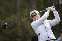 Eun-Hee Ji, of South Korea, watches her tee shot on the second hole during the final round of the Tournament of Champions LPGA golf tournament on Jan. 20, 2019, in Lake Buena Vista, Fla. (AP Photo/Phelan M. Ebenhack)