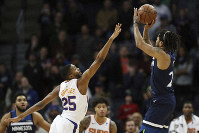Minnesota Timberwolves' Derrick Rose shoots the game-winning shot over Phoenix Suns' Mikal Bridges in the first half of an NBA basketball game on Jan. 20, 2019, in Minneapolis. Minnesota won 116-114. (AP Photo/Stacy Bengs)